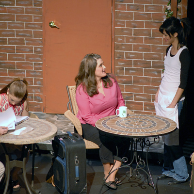 Tenille Nadkrynechny (left), Lianne Perry (center), and Alyisa Nicol (right) in a scene from Light in the Piazza